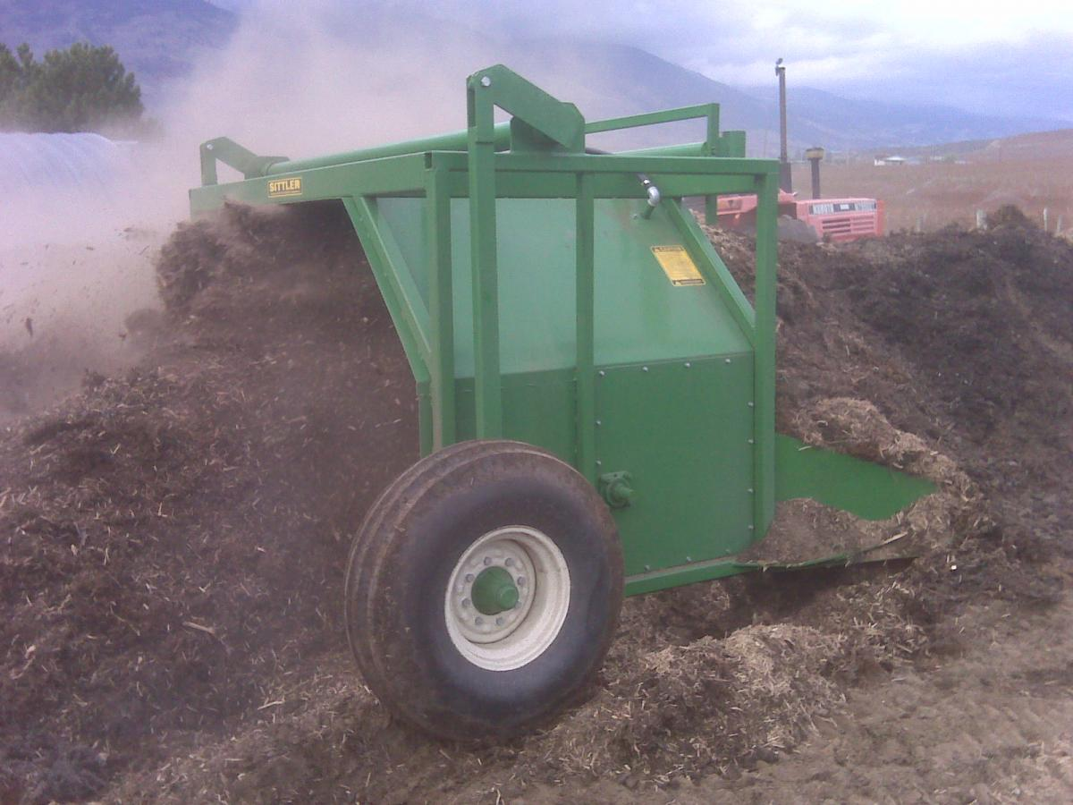 Mixing compost at a vineyard in Oliver